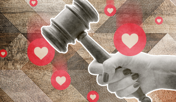 woman holding a judge gavel surrounded by hearts