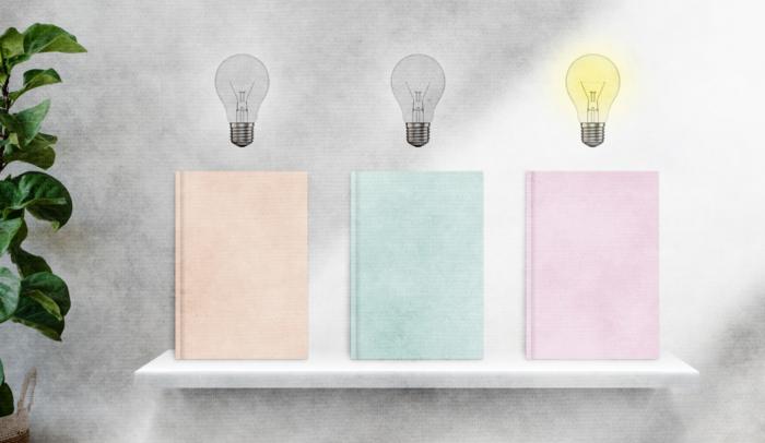 3 lightbulbs hanging over 3 books