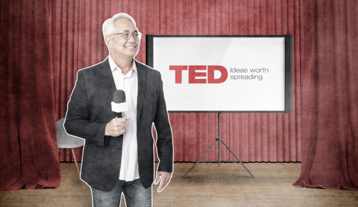 image of a man standing in front of a screen with ted talk logo