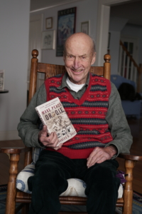 charles daly with his book