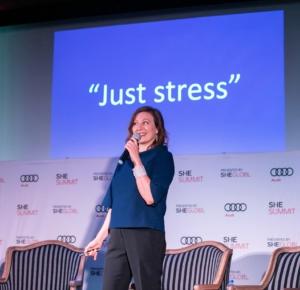 Valerie speaking on stage