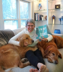 Patti with dogs and book