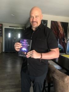 brian scott posing with book