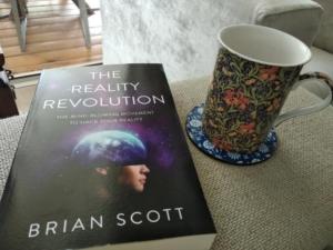 table with book and coffee mug