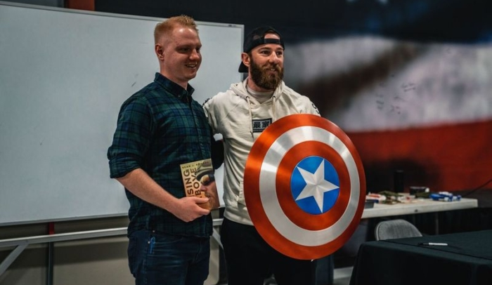 feature image sean rogers with shield and reader